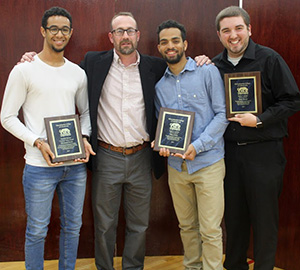 three students receiving leadership awards